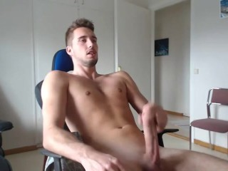 Guy with big cock masturbates while watching porn